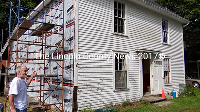 Contractor Richard Hatch wants to finish siding the exterior on the south and east sides of the former Nobleboro Grange #369, before taking on the restoration of the inside spaces of the building. Hatch bought the hall in late August. (Shlomit Auciello photo)