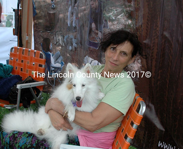 Max is up for adoption at Sheltie Rescue. The blind Sheltie cuddled with babysitter Annice when the sounds of Woofstock made him anxious.