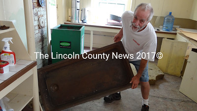 This cast-iron sink is among a number of original and historic components of the Nobleboro Grange that contractor Richard Hatch has found and hopes to include in his restoration of the building that was built at the start of the last century. (Shlomit Auciello photo)