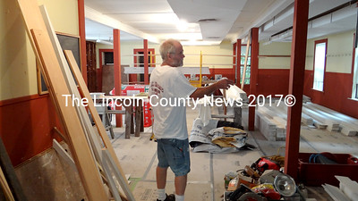 Contractor Richard Hatch plans to create a living space and workshop on the ground floor of the former Nobleboro Grange building. For now, he uses the space to store tools and supplies for work on the structure's exterior. (Shlomit Auciello photo)
