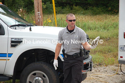 Lincoln County Sheriff's Deputy Todd Chilton displays the contraband found during the K-9 demonstration. (J.W. Oliver photo)