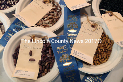 "Hubert ""Sam"" Birch, of Coopers Mills, won dozens of ribbons at the 2012 Common Ground Country Fair for his dry beans, garlic and other produce. (Shlomit Acuiello photo)"