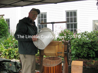 Selectman Bill Benner pressed cider onsite that was downed as quickly as it was made.  (E. Busby photo)