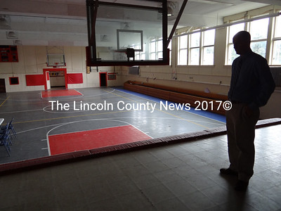 Central Lincoln County YMCA Executive Director Craig Wilson said the existing gym floor would remain in place. He said the synthetic tiles provide a good surface for a variety of activities and are easier to maintain than a wood floor. (Shlomit Auciello photo)