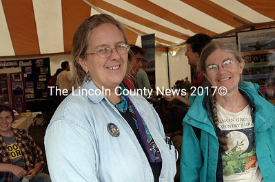 In Common Ground Coutry Fair's Young Maine tent, University of Maine Cooperative Extension Educator Ellie Libby and Kathy Cartwright, both of Waldoboro, discuss plans for the Nature 4-H Club that Cartwright supervised last year at Warren Community School. (Shlomit Auciello photo)