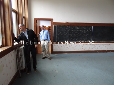 Central Lincoln County YMCA board member Tor Glendinning and Executive Director Craig Wilson look over a second floor classroom that could be merged with another to become an aerobics and yoga space, as renovations transform the former A.D. Gray School into the Waldoboro YMCA. (Shlomit Auciello photo)