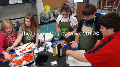 Students in Ken Williams' seventh grade classroom at Nobleboro Central School learn to make Caprese salad as part of the Focus on Agriculture in Rural Maine Schools program. (Shlomit Auciello photo)