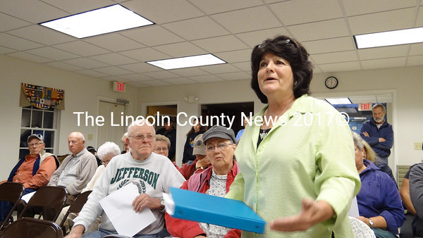 Goose Hill Road resident Suzanne Hamilton addresses the Jefferson Board of Selectmen at a public hearing to discuss a ballot question calling on citizens to grant the town an easement over the road. (Shlomit Auciello photo)