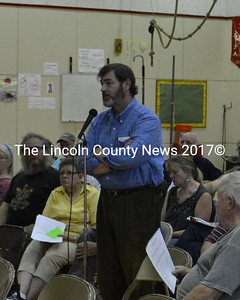 Paul Kelley, manager of Pleasant Pond Mill LLC, speaks at the special town meeting held in Whitefield May 30. (D. Lobkowicz photo)