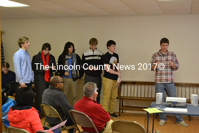 Members of Lincoln Academy's service fraternity Alpha Sigma Gamma read quotes of Martin Luther King Jr. Standing, from left: Loring Schaible, Mitchell Boucher, Griffin Han-Lalime, Seward Matel, Josh Hoepner and Ben Stone. (D. Lobkowicz photo)