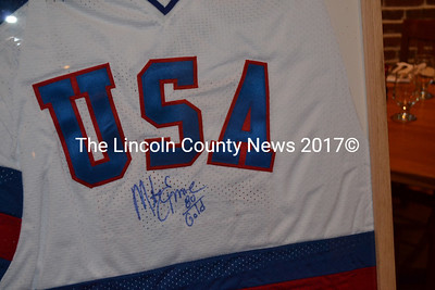 The signature of 1980 USA Olympic Hockey Team Captain Mike Eruzione on a replica jersey will be raffled in March.