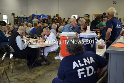 Just ten minutes into serving dinner, the Alna fire house is full to near capacity. (Kathy Onorato photo)