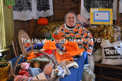Bremen Patriotic Club member Janet Cotton poses with pumpkin hats and other crafts she sold at the Bremen Country Fair on Oct. 5. (D. Lobkowicz photo)