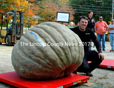 Edwin Pierpont with the largest giant squash in the world, weighing in at 1264 lbs. (Eleanor Cade Busby photo)