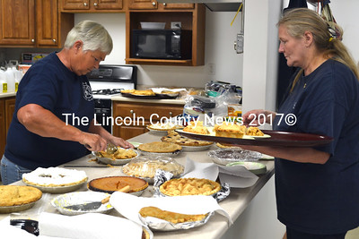 Collen Trask (left) and Cindy Seigars get the pie ready to serve. (Kathy Onorato photo)