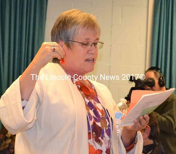 Wiscasset resident Judy Flanagan makes a motion to put the assessing agent's salary back in the budget, and explains why it is the best resolution for the town, at Wiscasset's open town meeting Oct. 8. (Charlotte Boynton photo)