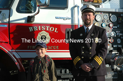 Bristol 3rd Assistant Fire Chief Neil Kimball poses with passenger Jayson Benner. (J.W. Oliver photo)