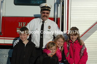 Bristol 1st Assistant Fire Chief Jared Pendleton drops off (from left to right) Ashton, Ryan, Serena and Megan Foster at school Oct. 9. The Bristol Fire and Rescue Ladies Auxiliary raffled the rides to school at the recent Bristol Mills Fall Festival. (J.W. Oliver photo)