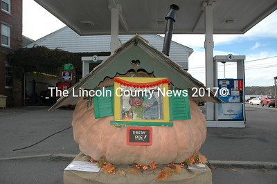 South Bristol artist Melissa Glendinning sculpted this fairy-tale cottage with a 1091-pound pumpkin grown by Charlie Lopresti of Buxton. (J.W. Oliver photo)