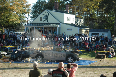 The second drop was Charlie Lopresti's Giant Pumpkin, which topped out at over 1000 pounds. The new height of the crane and the winds made the drops a little more difficult than in years past. The onlookers cheered as the huge fruit landed on the roof of the vehicle. (Eleanor Cade Busby photo)