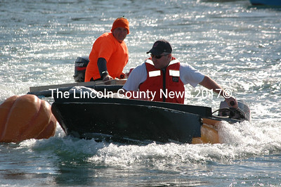 Christian Rioux of Freeport completes a lap in The Black Widow during the Damariscotta Pumpkinfest Regatta. Buzz Pinkham of Damariscotta follows close behind. Rioux would go on to win the motor division for the second time in three years. (J.W. Oliver photo)