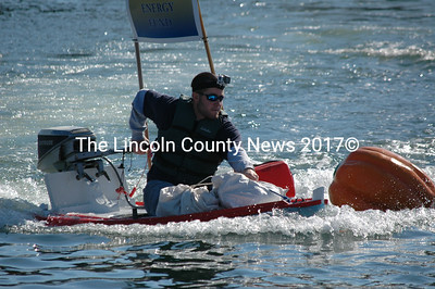 Matt Poole of South Bristol pilots a Colby & Gale entry in the Damariscotta Pumpkinfest Regatta. Poole was neck-and-neck with the eventual winner for most of the race, but finished fourth after his outboard motor failed during the final lap. (J.W. Oliver photo)