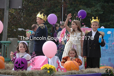 A group of children wave to the crowd from a float in the Giant Pumpkin Parade. (J.W. Oliver photo)