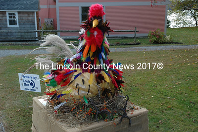 Louis Doe Home Center sponsored and decorated this rooster pumpkin with a 207-pound fruit grown by Abigail Higgins. (J.W. Oliver photo)