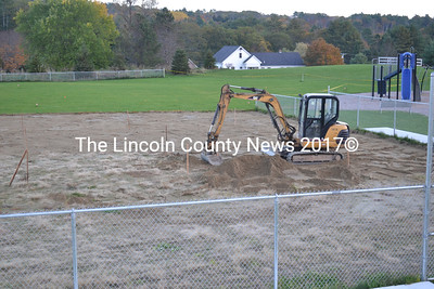 The top four inches of material on the area of the softball infield on the far side of the excavator had been removed as of Oct. 15. (D. Lobkowicz photo)