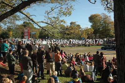 The crowd exceeded 1200 for Sunday's Pumpkin Drop. The event, previously held on Mondays, had busses of visitors parked along the street to watch the 180 foot drop at Round Top Farm. (Eleanor Cade Busby photo)