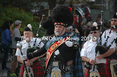 A bandleader marches in the Giant Pumpkin Parade with his corps of bagpipers. (J.W. Oliver photo)