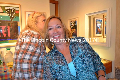 Harbor Crawlers led by Lori Pecor, the owner of Marketing Cents 4 U, visit Gold Smith Gallary in Boothbay, to enjoy the hospitality of the owner and the beautiful paintings. (Charlotte Boynton photo)