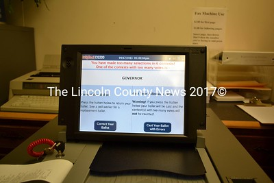 Wiscasset's new ballot counting machine alerts the voters to errors on their ballots, and gives them an opportunity to make corrections before accepting their ballots. (Charlotte Boynton photo)