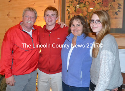 The Craig family in the living room of their Wiscasset home. From left, Glen, Matt, Sandy and Haylee. (Kathy Onorato photo)
