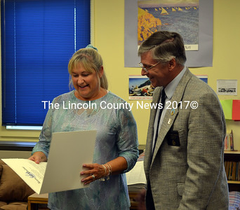 Former Wiscasset Middle School teacher Debbie Gray receives a Legislative Sentiment from Senator Chris Johnson. (Kathy Onorato photo)