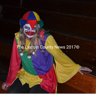 Not-so-sweet Wiscasset High School senior Alexa Burns greets Haunted High School visitors Oct. 25. (Kathy Onorato photo)