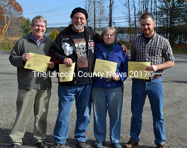 Lincoln County News staff, from left, Editor Sherwood Olin, Cartoonist Glen Chadborne, Photographer/Reporter Paula Roberts and Reporter Dominic Lobkowicz are recognized win in the Maine Press Association's 2013 Better Newspaper Contest. (Kathy Onorato photo)