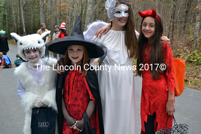 Heading out to collect candy on Dock Road in Alna are, (from left) Nelly Stafford, Grace Milliken, Maddy Kelly and Ava Toscano. (Kathy Onorato photo)