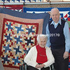 Robert Hills and his wife, Beverly were proud to accept the quilt Patriotic Glory sewn by Mainely Sewing. (Eleanor Cade Busby photo)