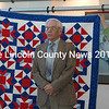 Peter Coffin was a Captain in the Army during WW II. He accepted his quilt, The Chevron Star, in honor of two fraternity brothers who never came home.  (Eleanor Cade Busby photo)
