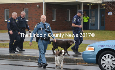 Waldoboro Police Chief Bill Labombarde (left) and School Resource Officer Tom Hoepner trail two members of the Maine State Police and their bomb-sniffing dogs after completing a search of Medomak Valley High School the morning of Nov. 18. (D. Lobkowicz photo)