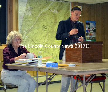 Edgecomb Town Clerk Claudia Coffin and moderator Chip Griffin prepare for Edgecomb's special town meeting on Nov. 18. (Kathy Onorato photo)