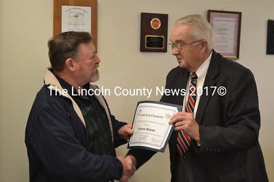 Now retired, Steve House (left) is recognized for his 26 years of service in communications by Lincoln County Commissioner William Blodgett during the commissioner's meeting  Nov. 19. (Kathy Onorato photo)