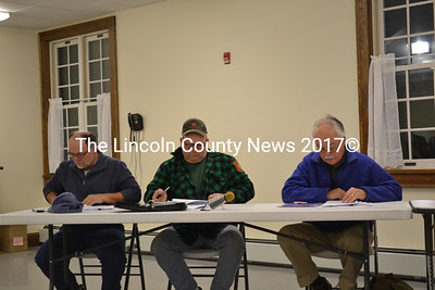 Dresden selectmen review the weekly warrant before approving it at their meeting Nov. 18, and are (from left) Selectmen Allan Moeller, Gerald Lilly, and Phil Johnston. (Charlotte Boynton photo)