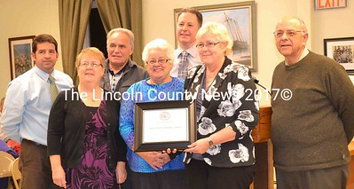 On behalf of the town, Wiscasset Selectman Edward Polewarczyk presented the Spirit of America Service Award to the administrators of the Wiscasset Community Center Cooper-DiPerri Scholarship Fund Nov. 19. Shown from left to right, administrators Todd Souza, Vickie Hersom, Bob Bickford, Katharine Martin-Savage, Brian Viele, Shelia Sawyer, and Polewarzcyk. (Charlotte Boynton photo)