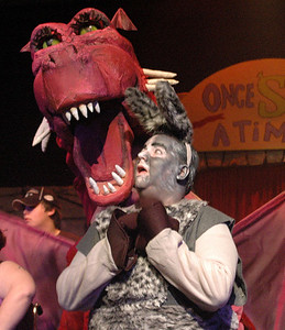 "Dragon (created by Melissa Glendinning and voiced by Tabitha Ordway, with movements by Kayleigh Tolley, Katherine Tolley, Sabrina Turner, Kat Pelkey and Jenni Prescott) protects her one true love, Donkey (Brad Fillion), in Waldo Theatre's production of ""Shrek the Musical."" (E. Busby photo)"