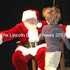 Santa had open arms for this little boy who ran headlong for the Jolly Old Elf's arms.  (Eleanor Cade Busby photo)