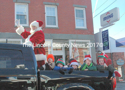 Santa arrives in ther Twin Villages Nov. 30, with his helpers from Coastal Kids. (Eleanor Cade Busby photo)