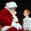 "Peyton Price had to explain a lot of things to Santa Claus in Damariscotta on Saturday. His conversation was a secret. When asked what he spoken about with Santa, he replied, ""Well, I can't tell you. That would ruin the magic."" (Eleanor Cade Busby photo)"