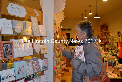 Lynn Cole of Bristol browses through the large collection of cards offered at Rock Paper Scissors. (Kathy Onorato photo)